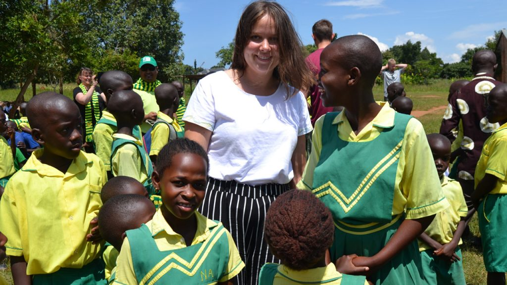 Anna, daughter of one of our customers, with the children from Child Africa's schools at the equator. 180703