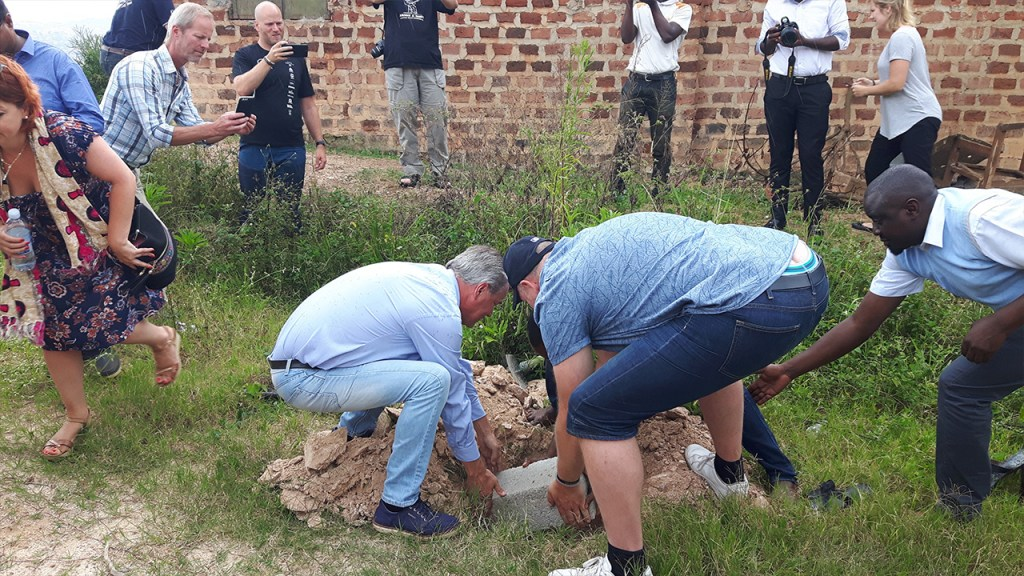 The foundation stone of the new office is put in its place.