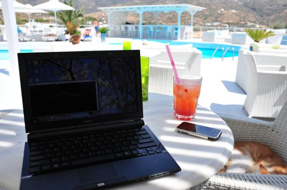 Laptop at pool by beach