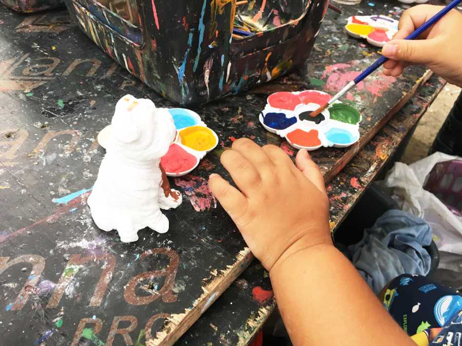 Try your hand at ceramic painting (image via Shutterstock)