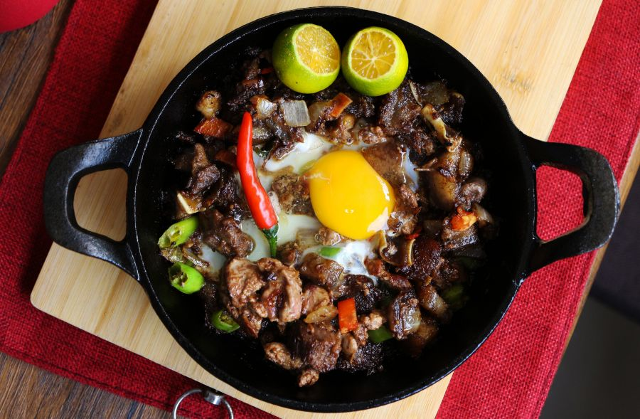 Sisig on a sizzling plate