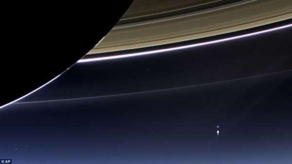Here is Earth from 900 million miles away, from the vantage point of the rings of Saturn.  Image via the Cassini spacecraft, which has been orbiting Saturn since 2004.