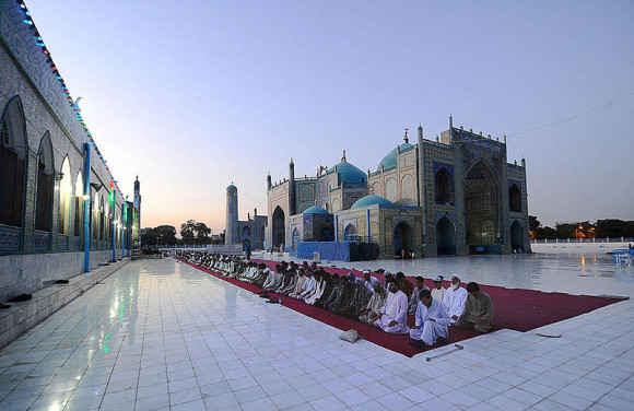 Men praying during Ramadan at the Blue Mosque in Mazar-i-Sharif, Afghanistan.