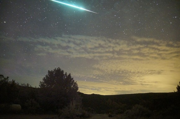 Mike Lewinski said this 2013 Perseid fireball was so bright that it illuminated the clouds.  Notice the greenish color.  Mike was at Embudo, New Mexico.  Thanks for posting!