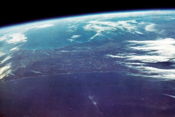 """Orbital view of Earth, mostly sea with some clouds.""""  Image via NASA"""