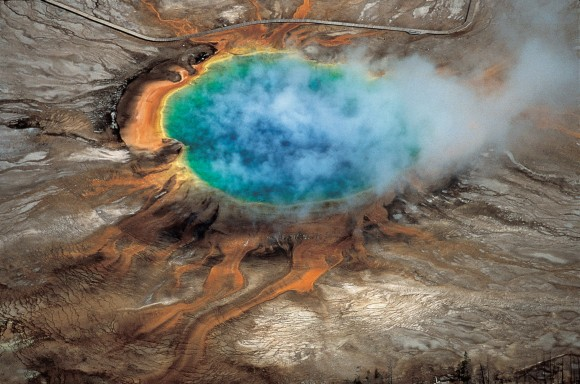 "The gorgeous colors of Yellowstone National Park's Grand Prismatic hot spring are among the park's myriad hydrothermal features created by the fact that Yellowstone is a supervolcano – the largest type of volcano on Earth. Photo credit: ""Windows into the Earth,"" Robert B. Smith and Lee J. Siegel"