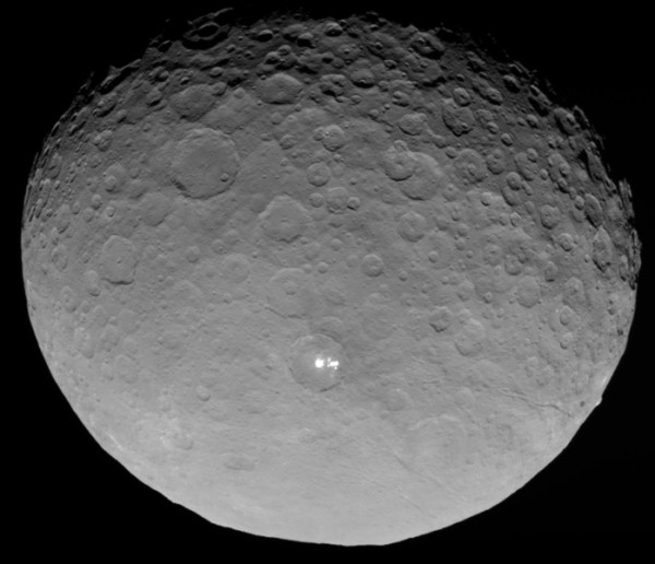 In this closest-yet view, the brightest spots within a crater in the northern hemisphere of the dwarf planet Ceres are revealed to be composed of many smaller spots. Their exact nature remains unknown.  Image via NASA Dawn mission.