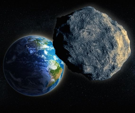 Artist's concept of a large asteroid passing Earth, via Shutterstock.