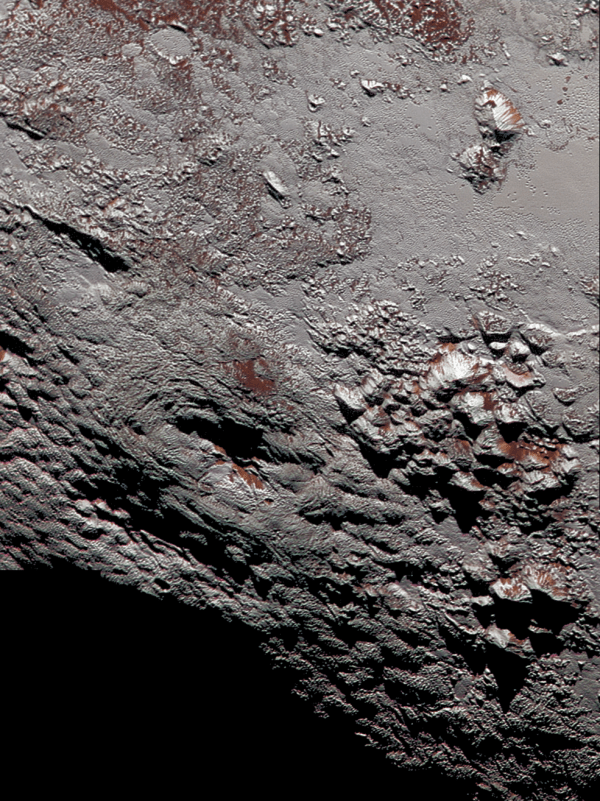 View larger. | This composite image of a possible ice volcano on Pluto includes pictures taken by the New Horizons spacecraft's Long Range Reconnaissance Imager (LORRI) on July 14, 2015, from a range of about 30,000 miles (48,000 kilometers), showing features as small as 1,500 feet (450 meters) across. Sprinkled across the LORRI mosaic is enhanced color data from the Ralph/Multispectral Visible Imaging Camera (MVIC), from a range of 21,000 miles (34,000 kilometers) and at a resolution of about 2,100 feet (650 meters) per pixel. The entire scene is 140 miles (230 kilometers) across. Credits: NASA/JHUAPL/SwRI
