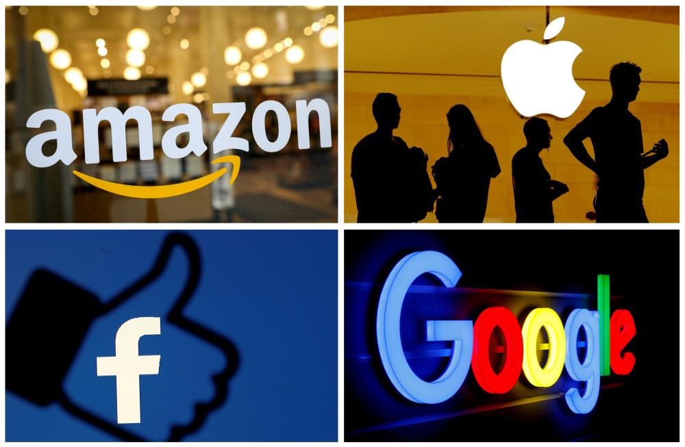 Tech earnings tsunami buoys Alphabet, sinks Apple