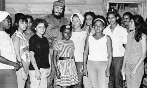 Fidel with adolescent girls in La Mota, a remote settlement in the Sierra Maestra mountains.