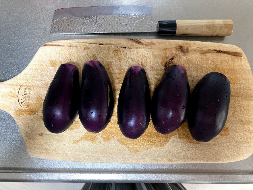 eggplants on a chopping board