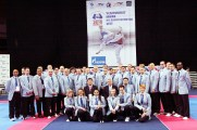 WTF President Chungwon Choue poses with International Referees.