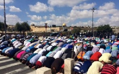 PALESTINIAN PEOPLE PERFORM FRIDAY PRAYER AT SIDE OF AL-AQSHA MOSQUE