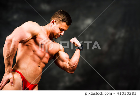 man flexing muscles against