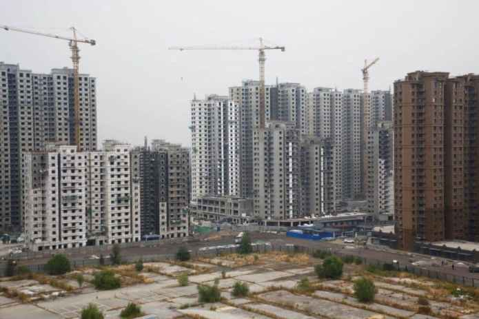 China's new home prices grew slightly in May