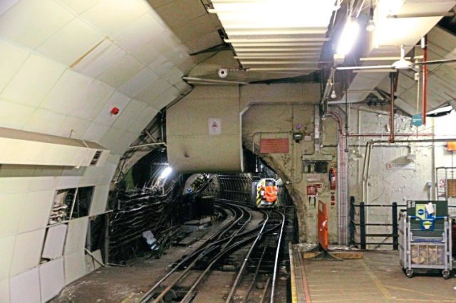 A February 2016 tunnel view with a contractor's loco in the distance. One of the Mail Rail 'Mini York' containers is on the platform the right.
