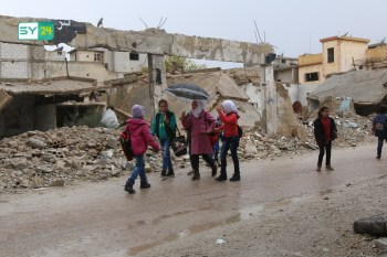 children continue to go to schools amidst the rubbles of the houses destroyed in the Russian and Syrian airstrikes on the area