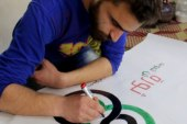 Caricature artist from Kafranbel city in rural Idlib dreams of turning his art into a profession
