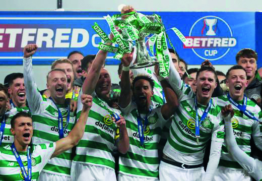 Celtic celebrate Betfred Cup victory. Photo by Russell Cheyne via Retuers (1)