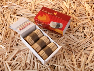 K-Lumet red packaging and a box with three fire-starters on top of lots of wood matches
