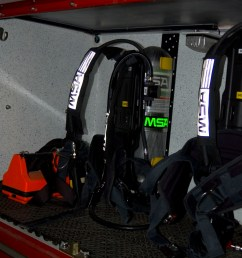 scba packs carried on a rack in a firetruck [ 2000 x 3008 Pixel ]