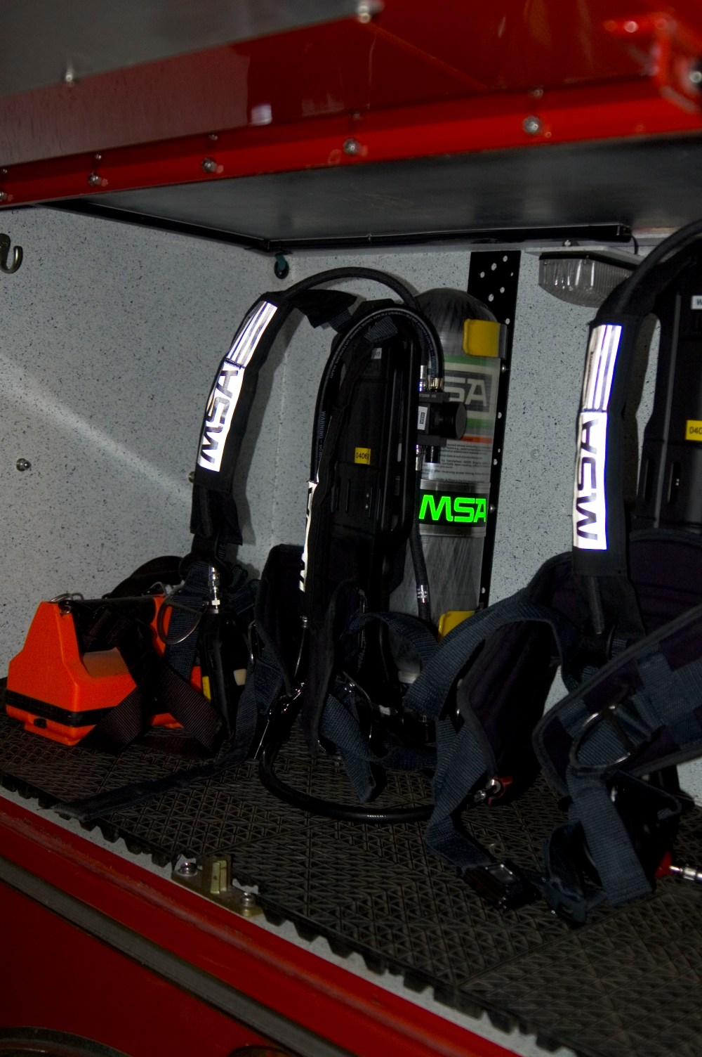 medium resolution of scba packs carried on a rack in a firetruck