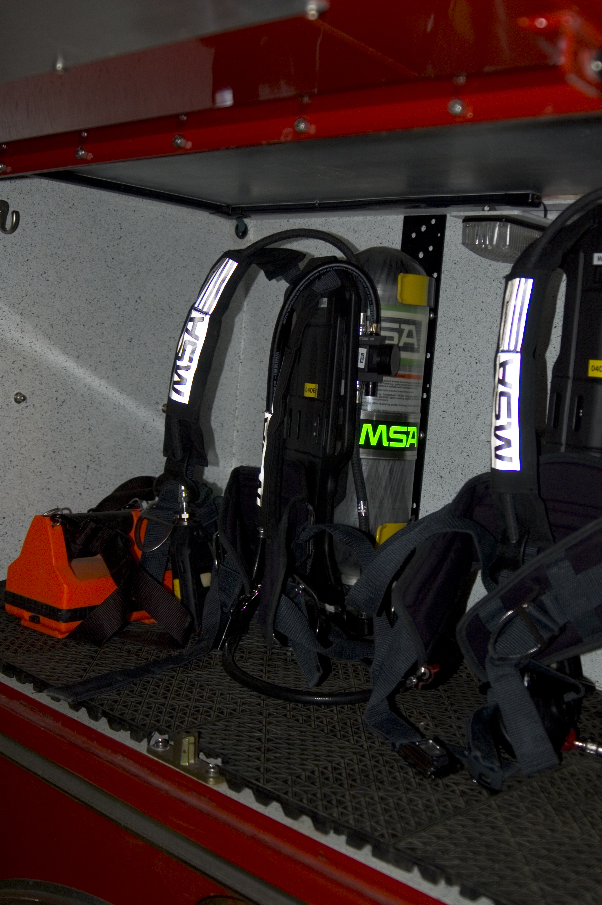 hight resolution of scba packs carried on a rack in a firetruck