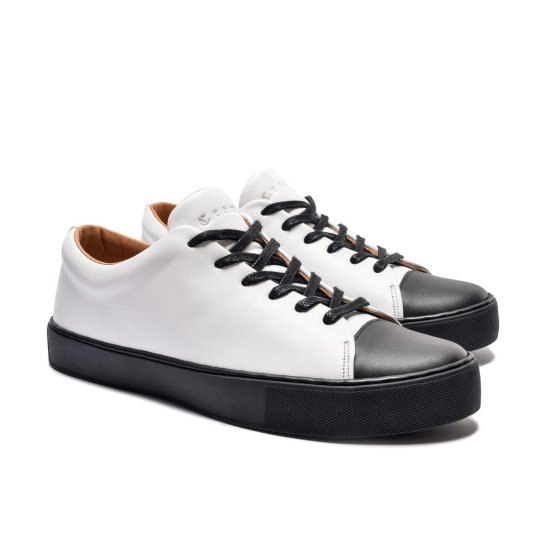 abington toe cap sneaker white black