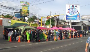 After the police action today, the hunger strike camp is condensed to the side of the road with a police line right next to it