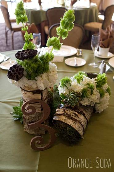 The vases are wrapped in wood to acheive a rustic look.