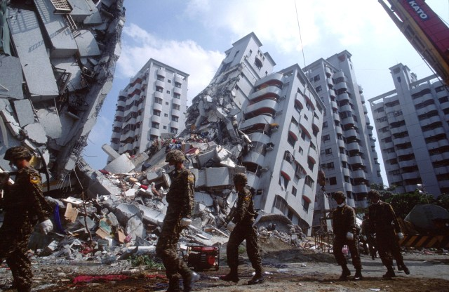 Sep 07, 1999; Tai Chung, Taiwan; The city of Tai Chung is struck by a huge earthquake killing more than 2,000 people. Taiwanese Army rescue workers hurry to find survivors in the mass destruction.