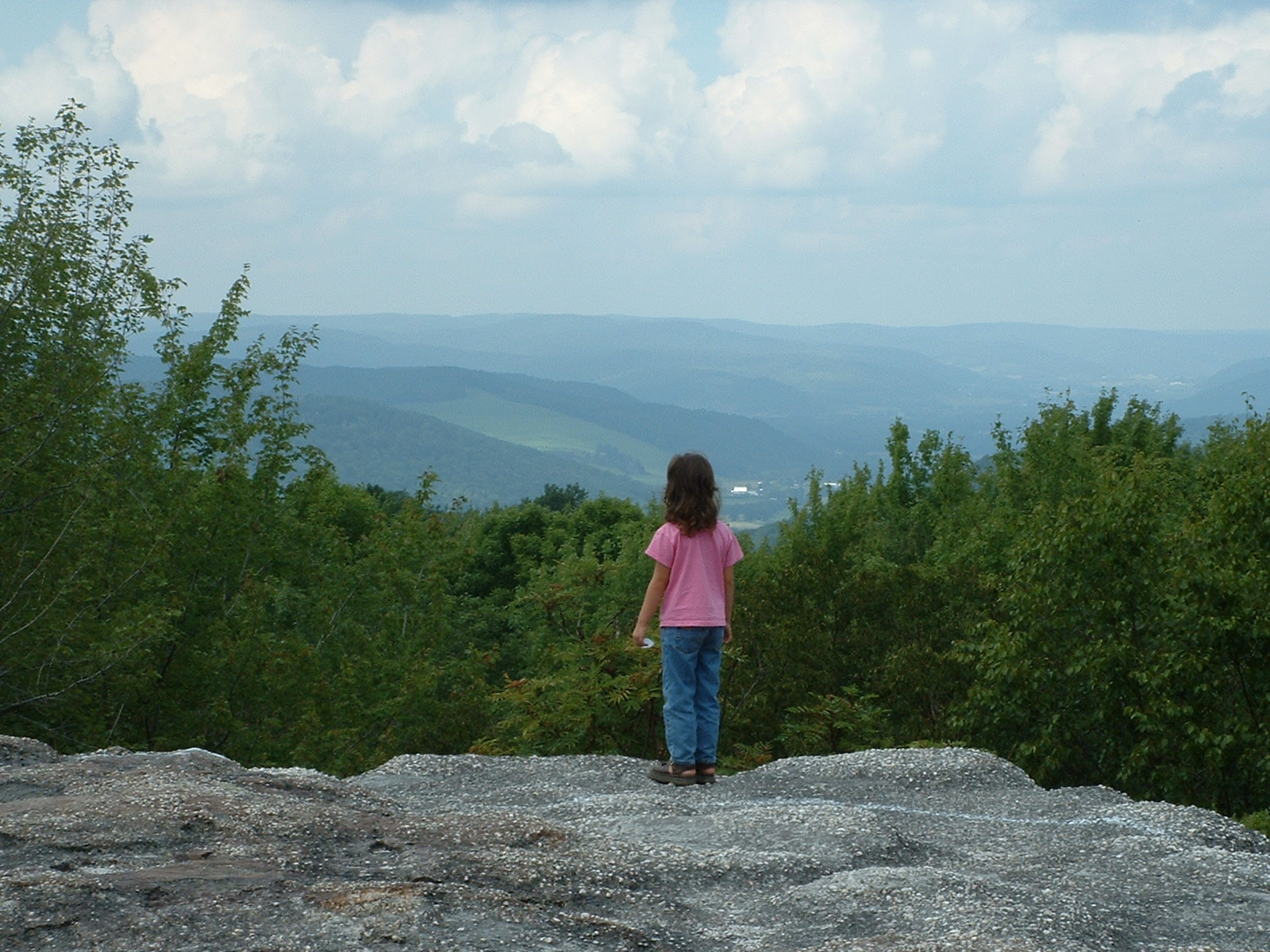 Photo of Little Girl on a huge rock  Enchanted Mountains