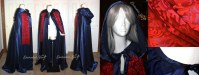 ucious navy satin is the base for this hooded Christine cloak. The scarf is made from silk devore satin, (the same kind of material used in Christine's dressing gown ruffles!), and dyed the perfect shade of scarlet. It is trimmed in extra long scarlet chainette fringe. A hidden hair pin is stitched in the top of the hood to help it stay upon the head, and custom matching bias tape lines the neck.