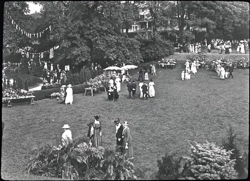 """Garden party at the Hartsdale Train Station in the Bronx, Sept. 20, 1919. The event was """"Floralia."""" Photo by Bronx Parkway Commission."""