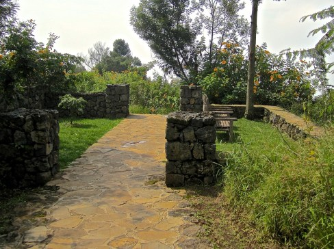 The central path crosses a garden room.