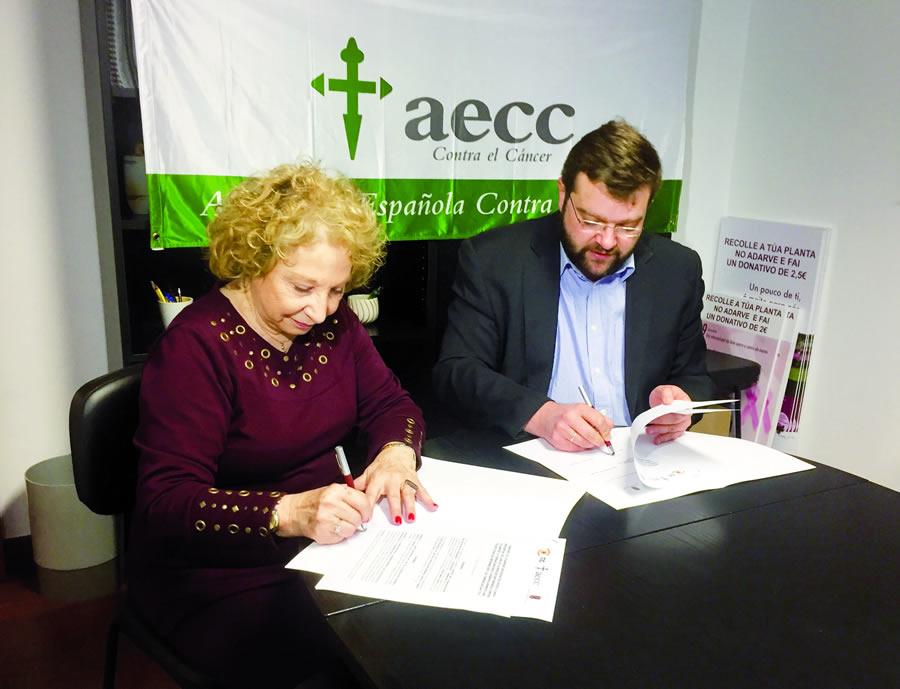 A presidenta da AECC de Lugo, Mariluz Abelleira, e o patrón da TIC e deputado de Relacións Institucionais, Álvaro Santos, na sinatura do convenio o pasado 23 de marzo. GPDL