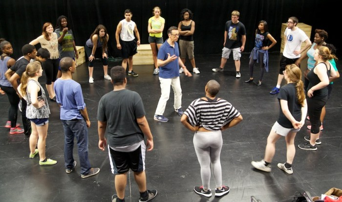 THE STUDENTS in the Alliance Theatre's 13th Collision Project trade ideas with actor Mark Cabus (center).