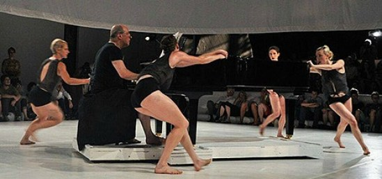 """Robert Spano (at piano) and the """"cloth {field}"""" dancers."""