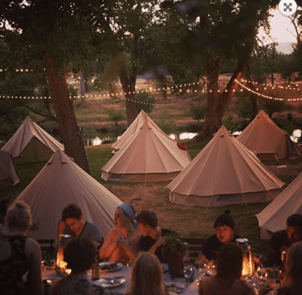 Dinner with friends beneath the stars and twinkling lights.