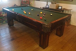 used pool tables, shuffleboard tables, foosball tables, bars and barstools, darts