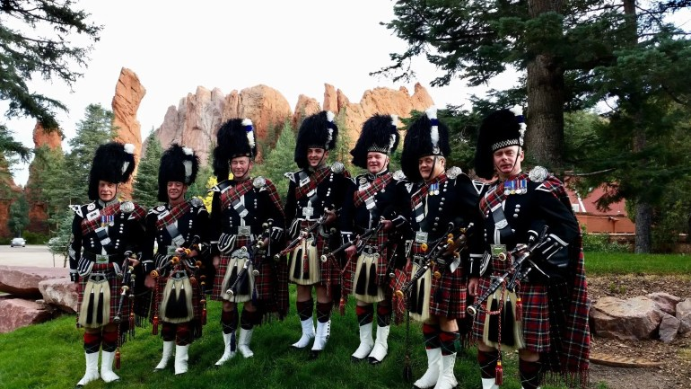Kenneth McBride, with pipe band