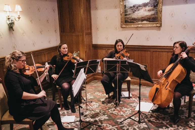 Toscana strings performing in a manor house