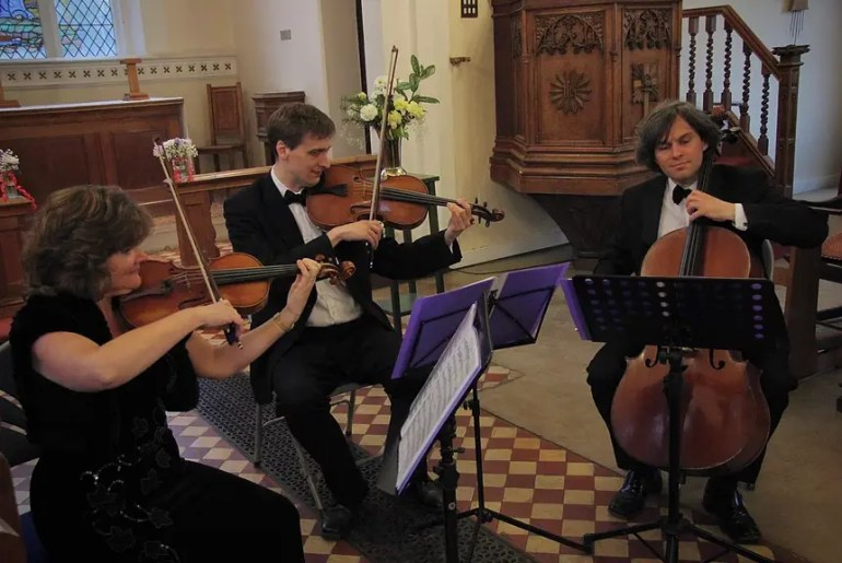 The Element String Trio playing in a church