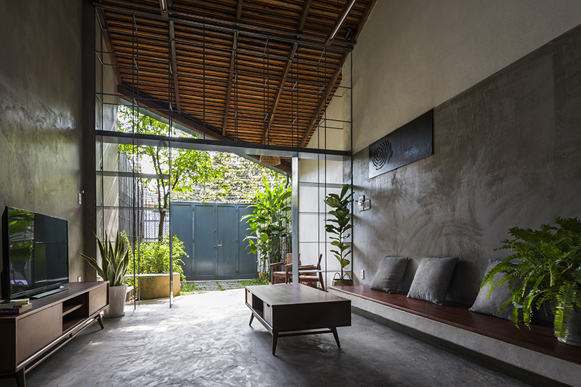 23o5 studio merge interior and exterior spaces in this vietnamese house