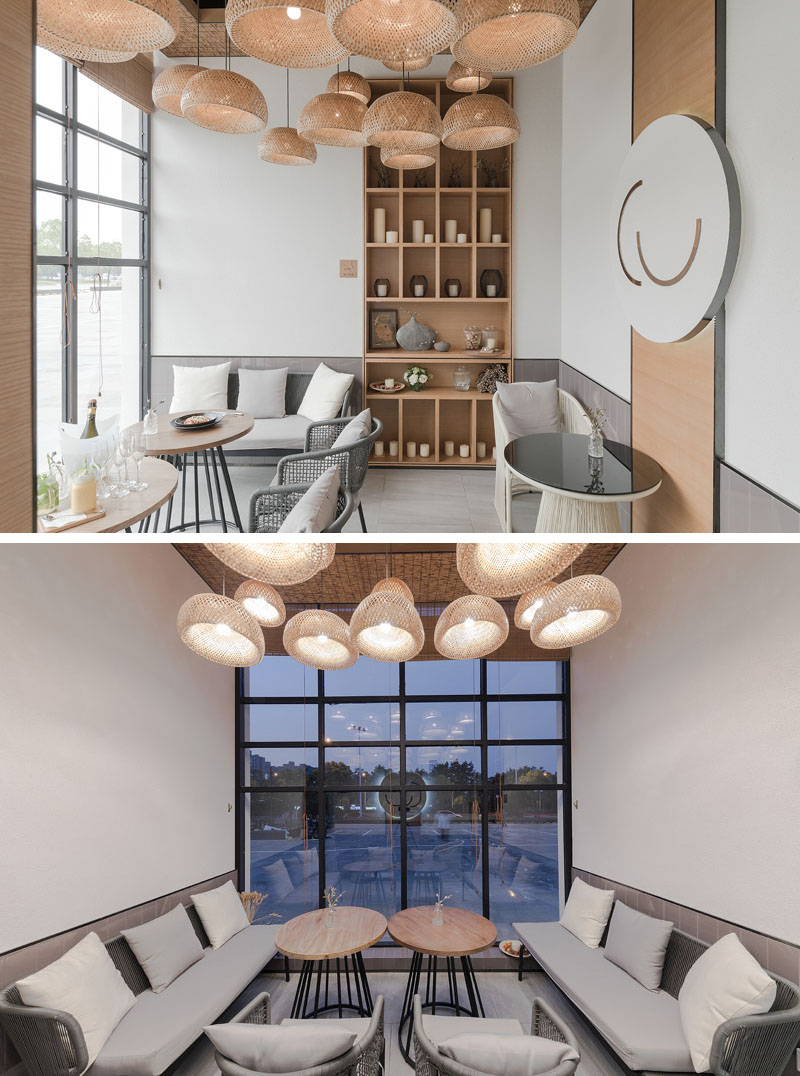 This modern coffee shop has a semi-private 'glass room', that has couches and tables that look out of the floor-to-ceiling windows to the street. #ModernCoffeeShop #CafeDesign