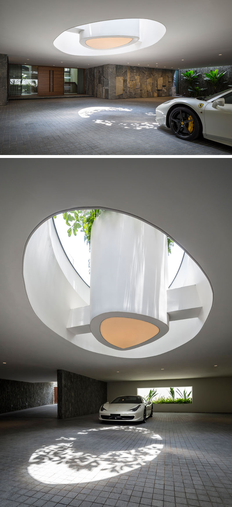 This modern garage features stone elements to help create a cave-like appearance. A large open skylight provides natural light and venting to the garage, and within the skylight is a planter that floats within the swimming pool above. #Garage #Architecture