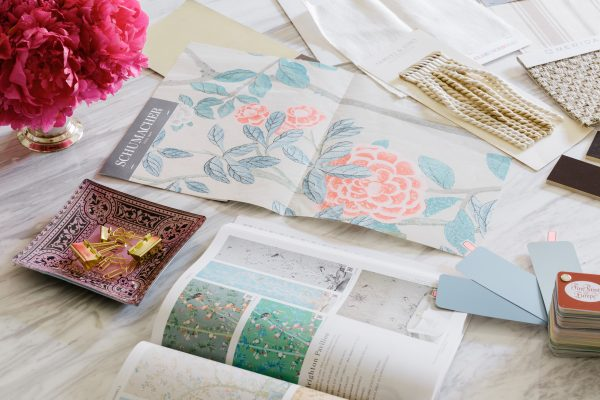 Setting Intentions for 2019. A picture of a floral pattern as well as a interior design book with colour swatches.