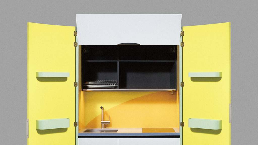 A yellow two door Japanese micro kitchen with black interior shelving