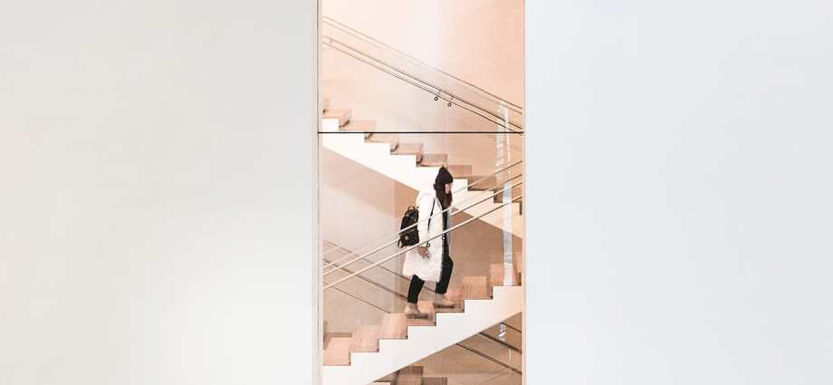 Vertical image of steps with asian woman walking up them